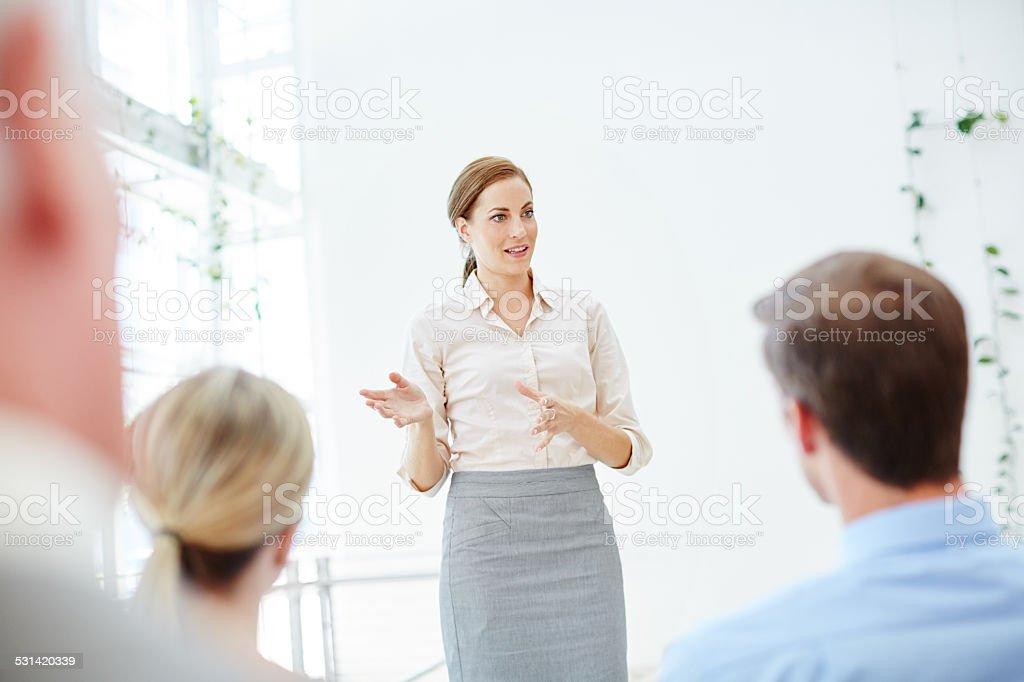Addressing her peers stock photo
