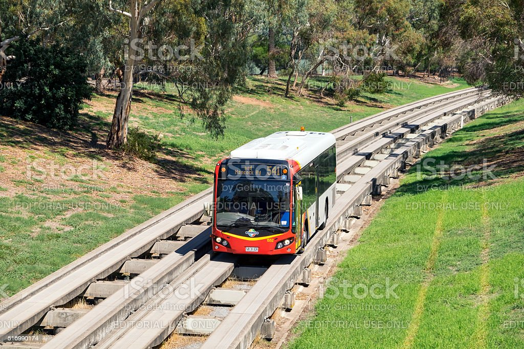 Adelaide Metro Bus travelling along O-Bahn guided busway stock photo