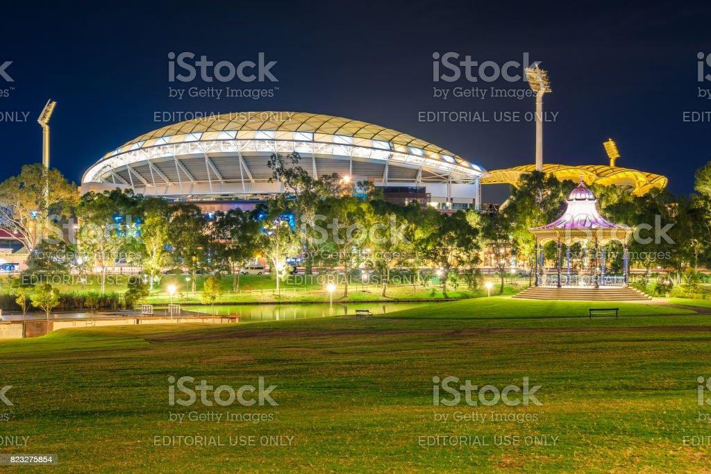 Adelaide oval with rotunda illuminated at night stock photo