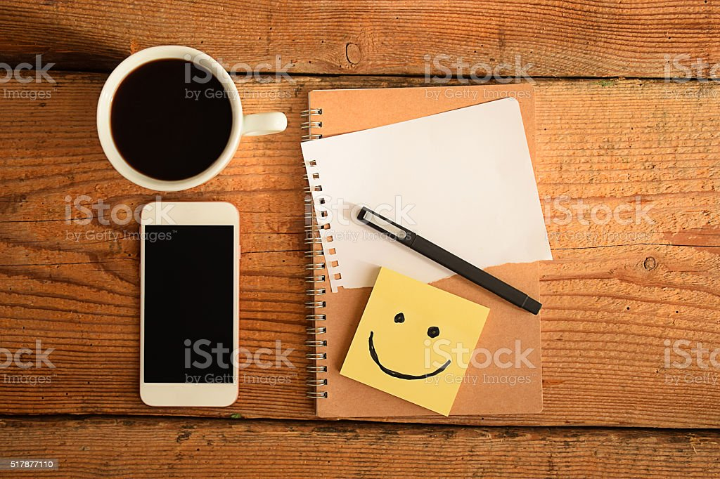 Adhesive note on desk stock photo
