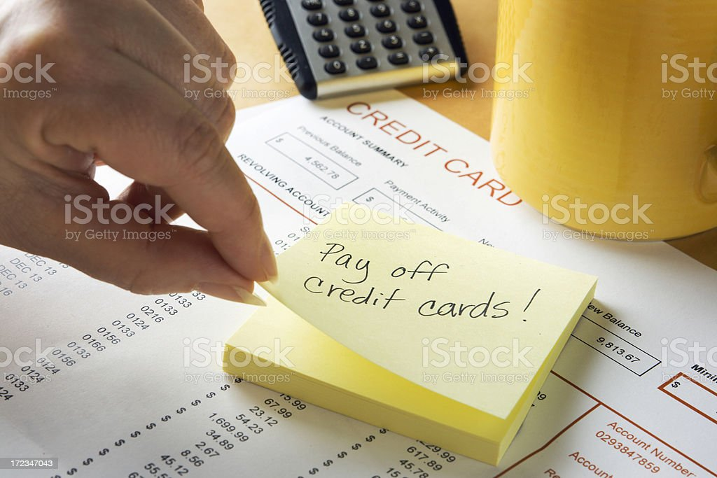 Adhesive Note Reminder for Credit Card Debt Bill Financial Problem stock photo
