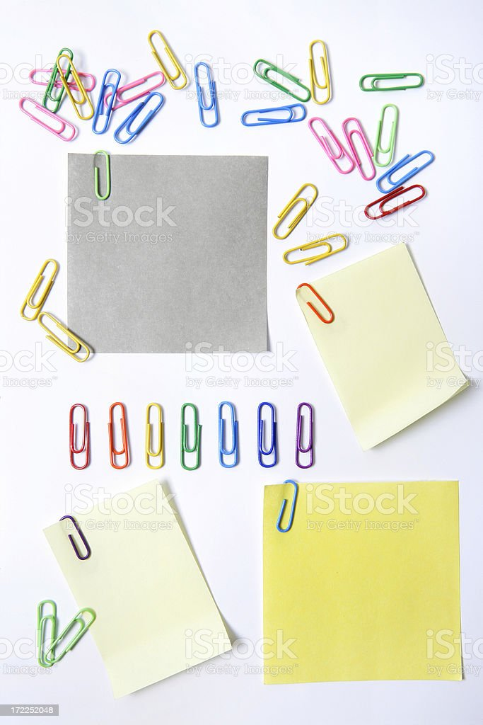 Adhesive notes and paper clips royalty-free stock photo