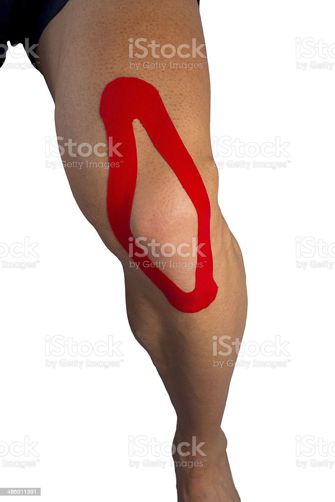 Adhesive tape because of knee ache stock photo