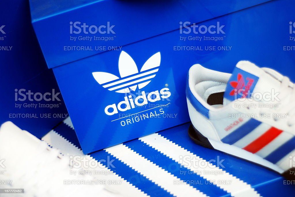 Adidas shoes in store window stock photo