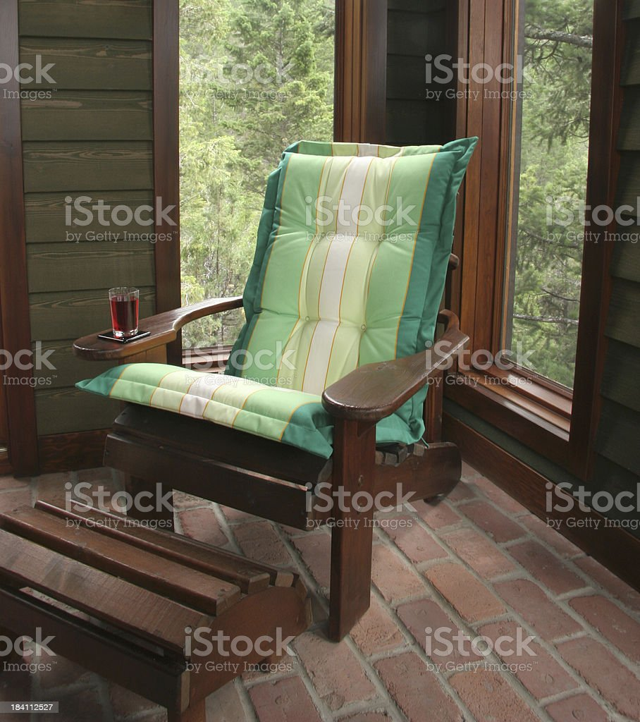 Adirondack Chair and The enclosed  Screened In Porch royalty-free stock photo