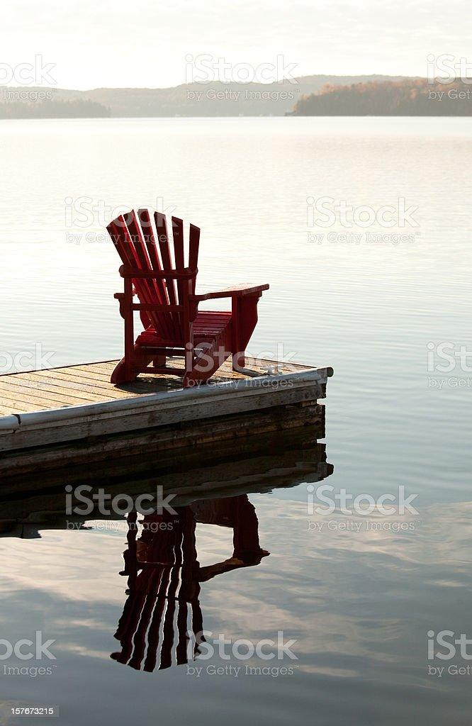 Adirondack Chair by the Lake stock photo