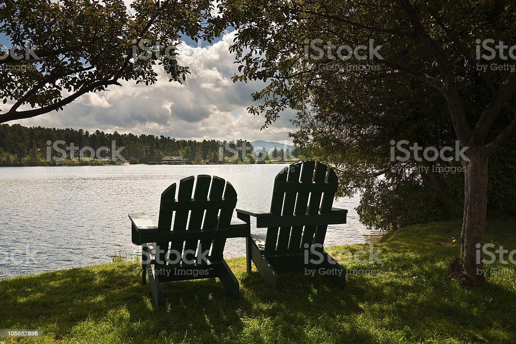 Adirondack  Chairs by Lake stock photo