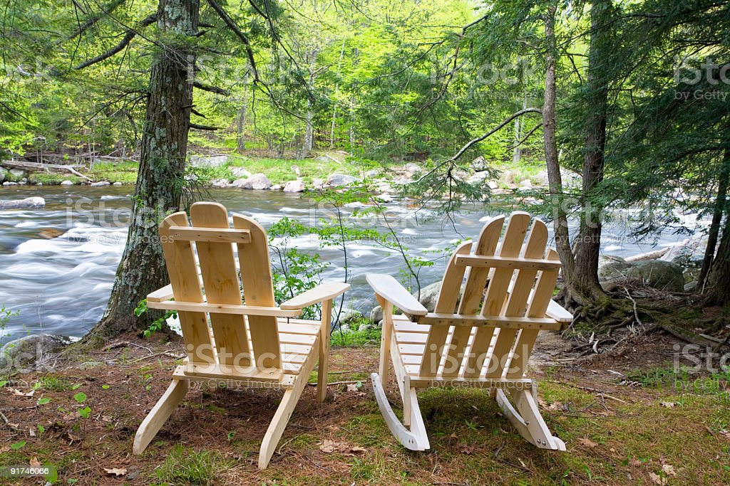 Adirondack Chairs By The River royalty-free stock photo