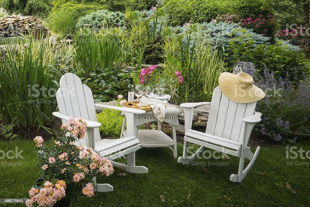 Adirondack chairs in the garden stock photo