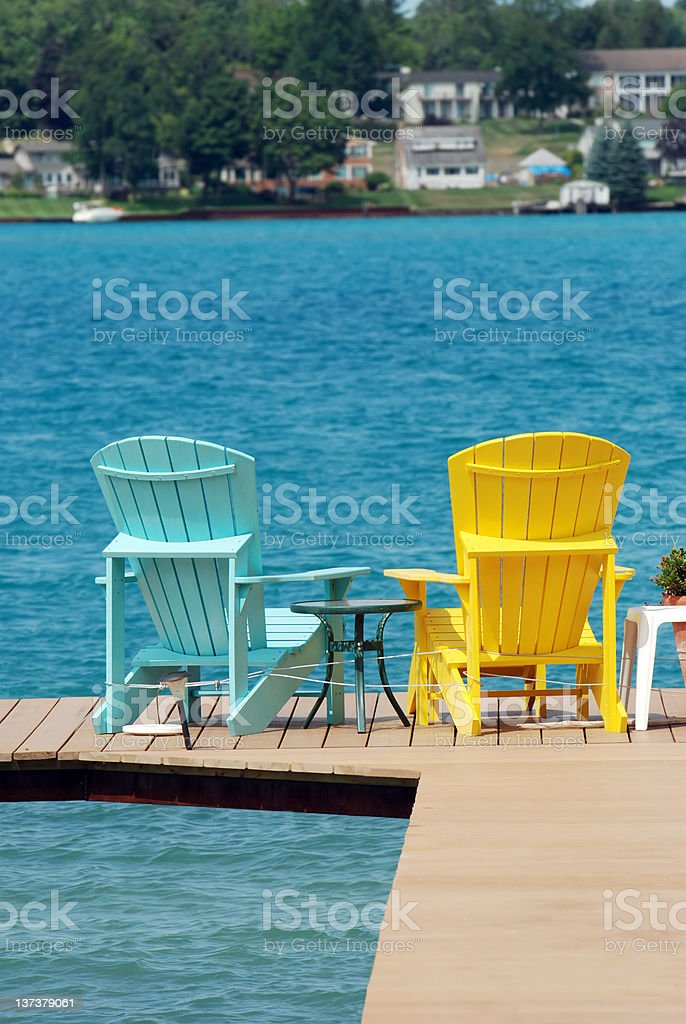 adirondack chairs on a dock royalty-free stock photo