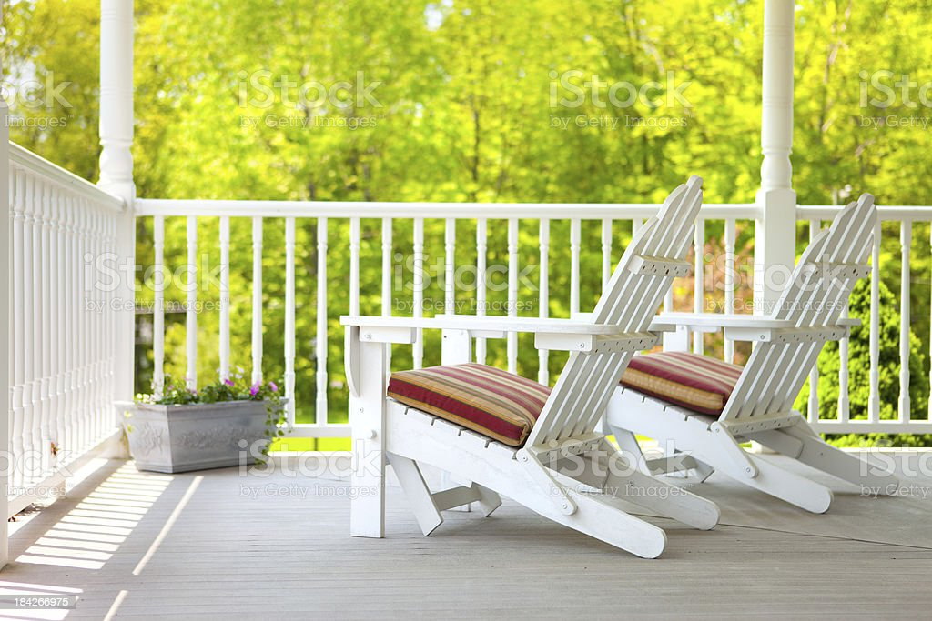 Adirondack chairs on a porch stock photo