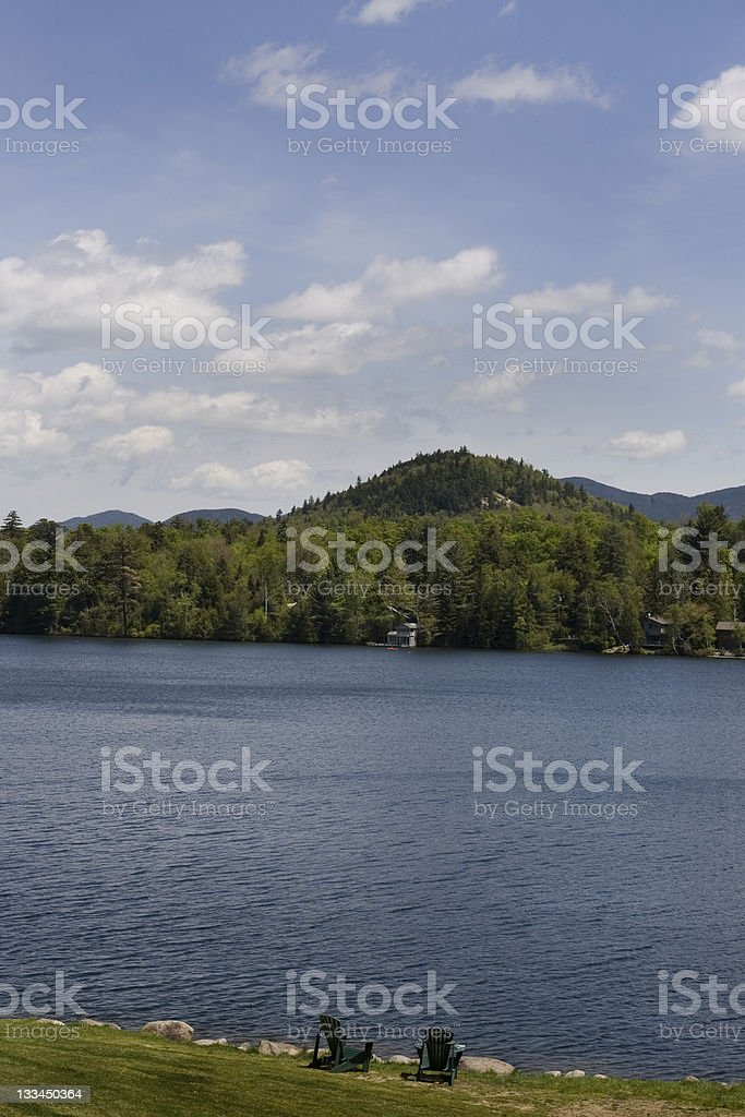 Adirondack chairs on the edge of Mirror Lake stock photo