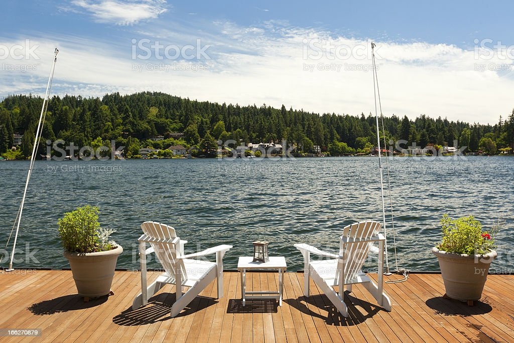 Adirondacks on lakeside Deck royalty-free stock photo