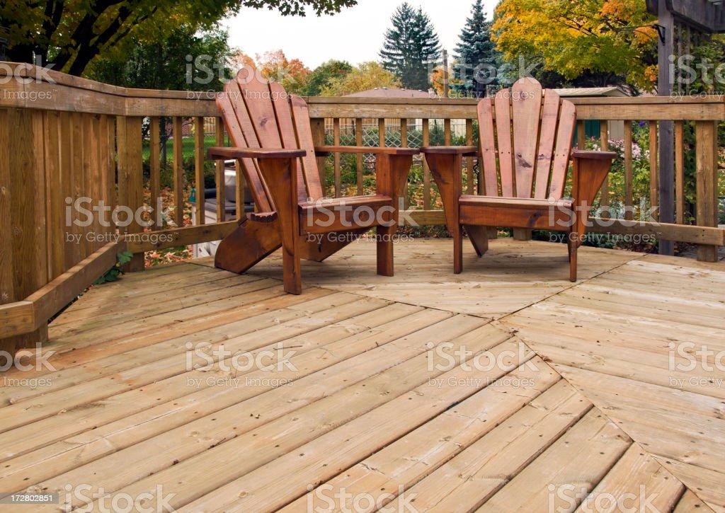 Adirondak chairs on backyard wood deck royalty-free stock photo