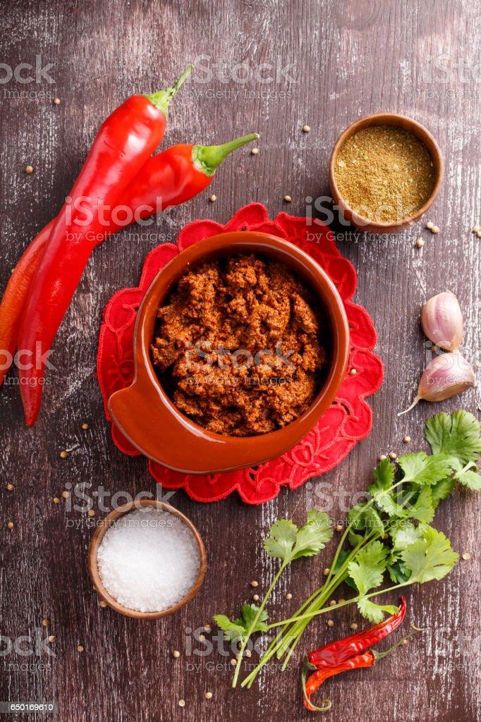 Adjika or ajika Hot spicy flavored sauce stock photo