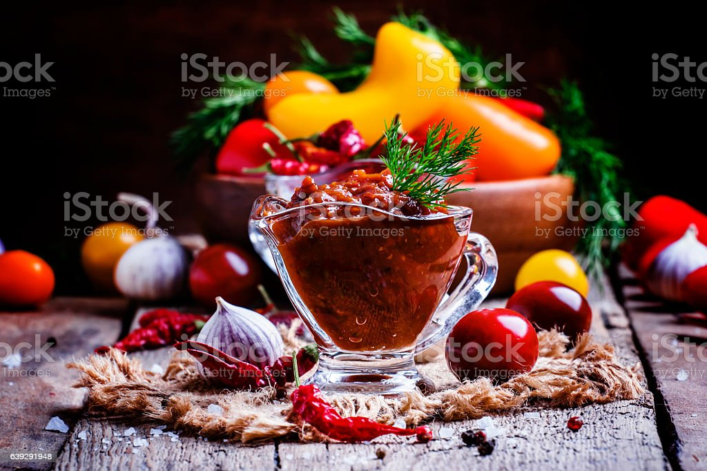 Adjika - traditional Armenian spicy sauce from tomatoes stock photo