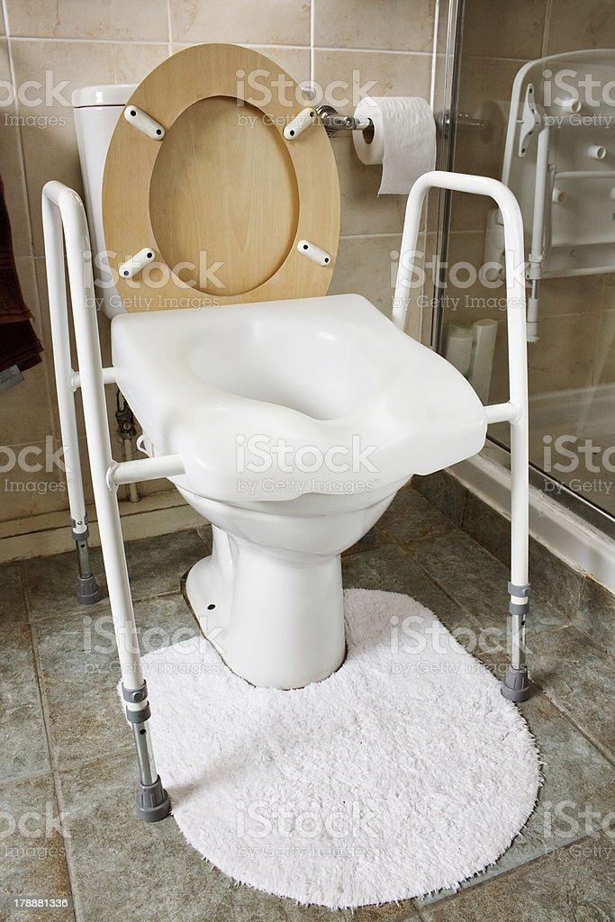 Adjustable height toilet seat stock photo