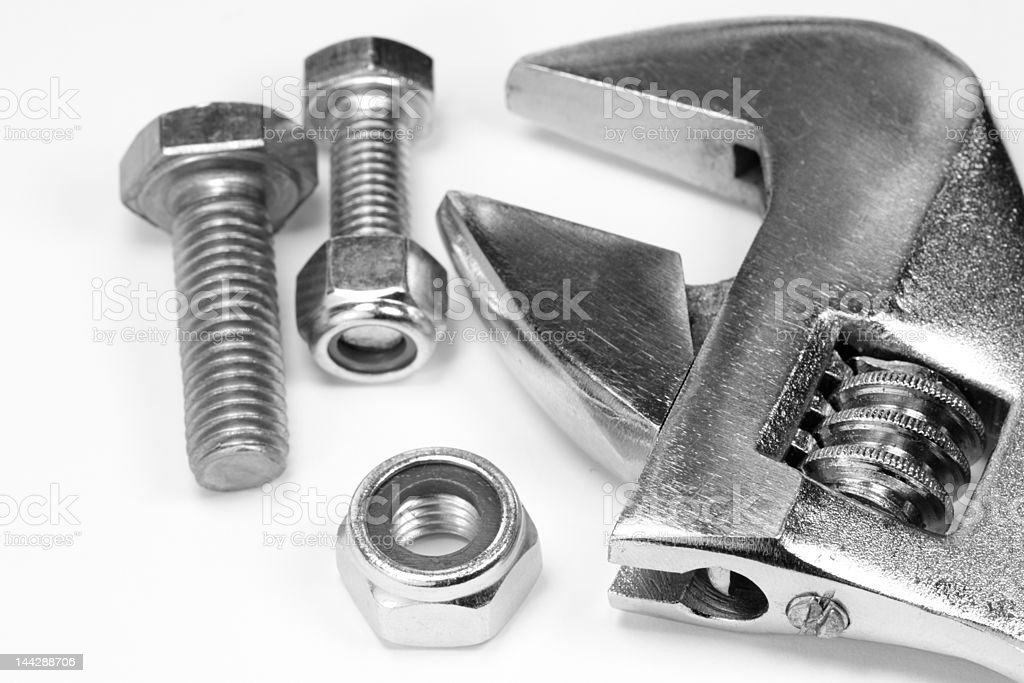 Adjustable wrench, nuts and bolts. royalty-free stock photo
