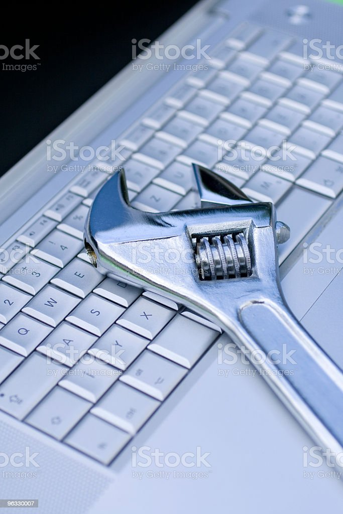 Adjustable wrench on a laptop. royalty-free stock photo