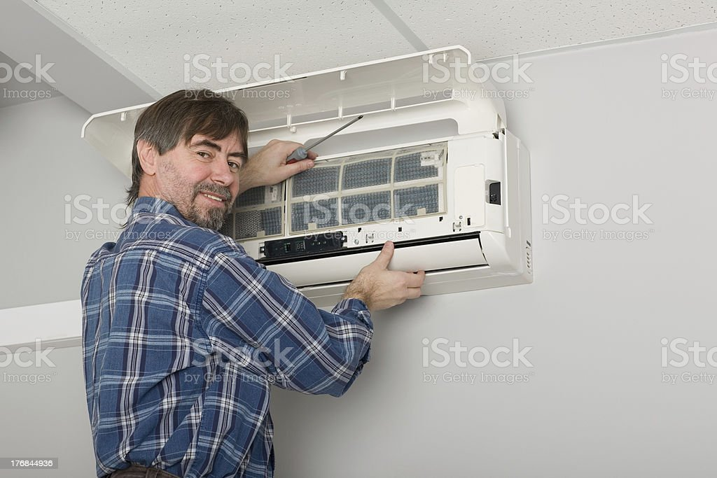 Adjuster adjusting air conditioning system royalty-free stock photo