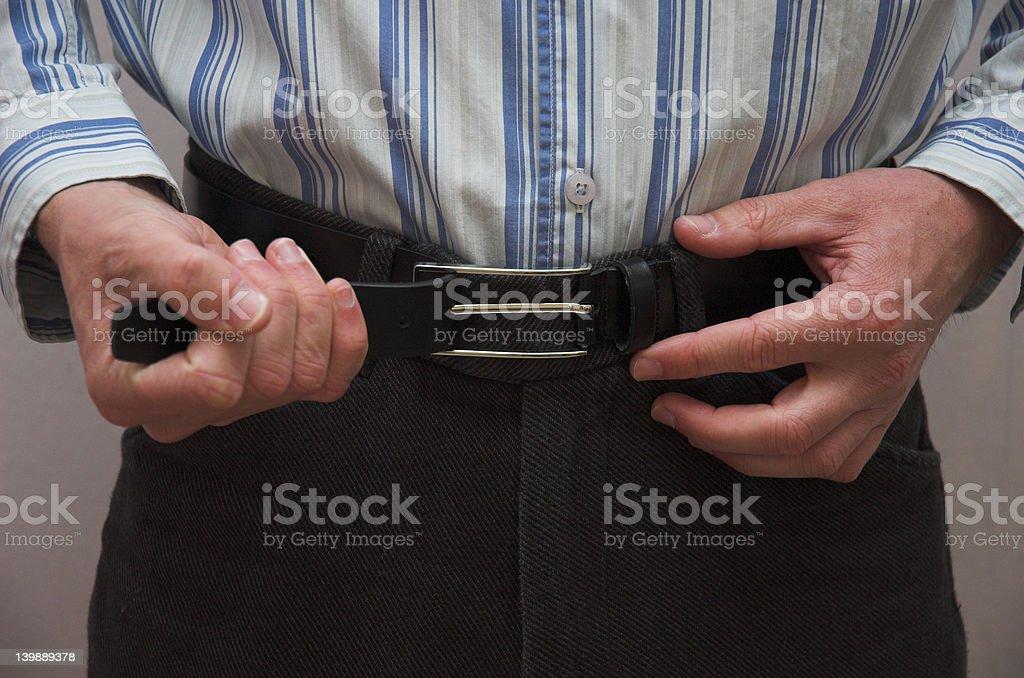 Adjusting Belt royalty-free stock photo