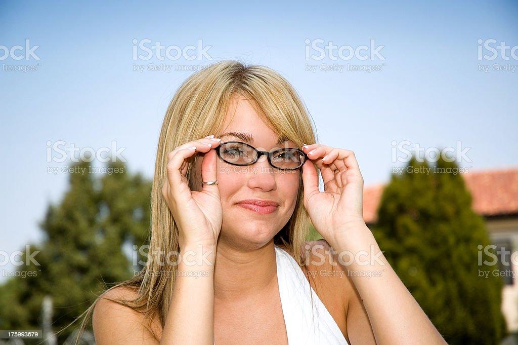 Adjusting Glasses royalty-free stock photo