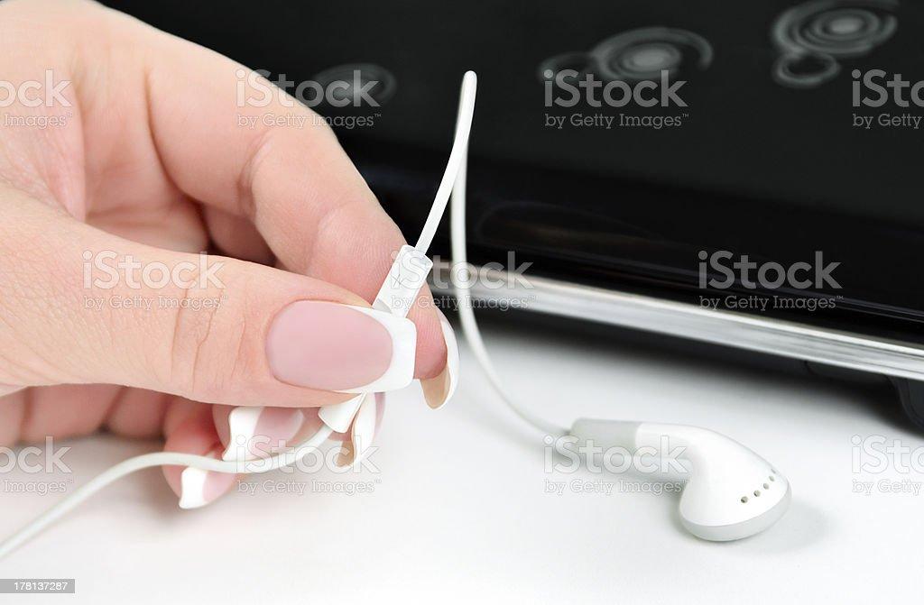 adjusting headphones volume royalty-free stock photo