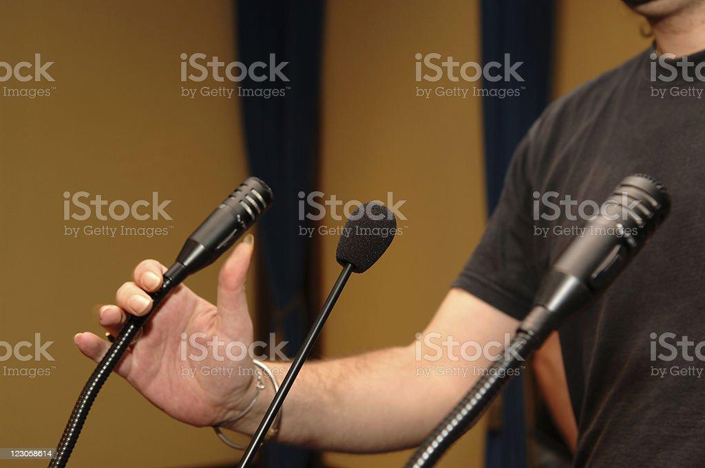 adjusting microphones royalty-free stock photo