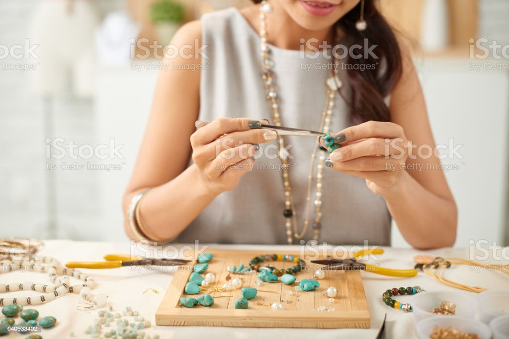 Adjusting parts of earring stock photo