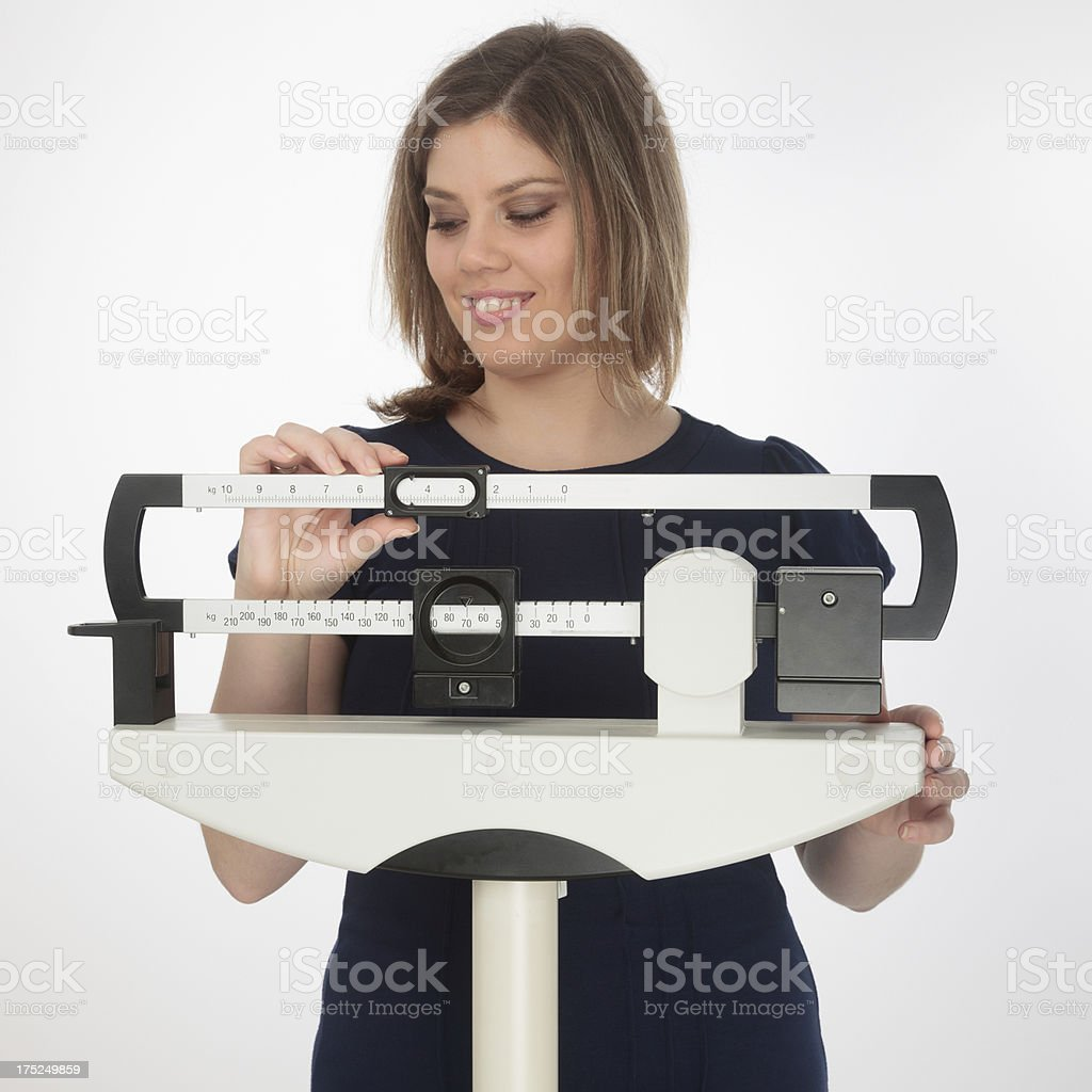 Adjusting scale royalty-free stock photo