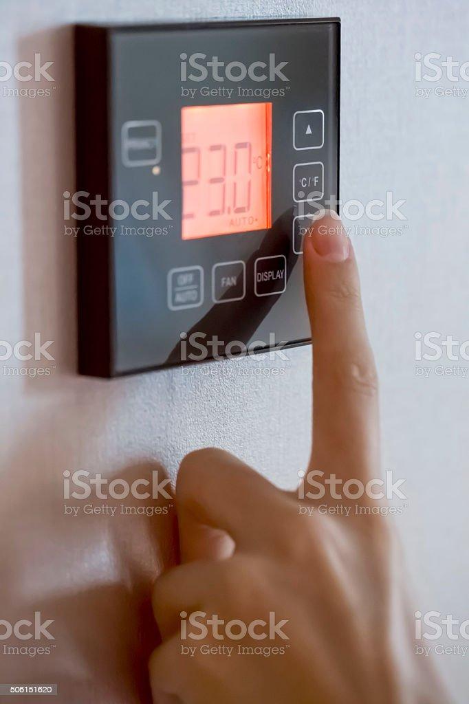 Adjusting temperature stock photo