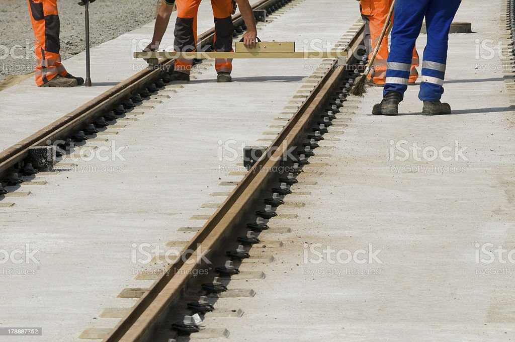 Adjusting the track width of the railway tracks stock photo