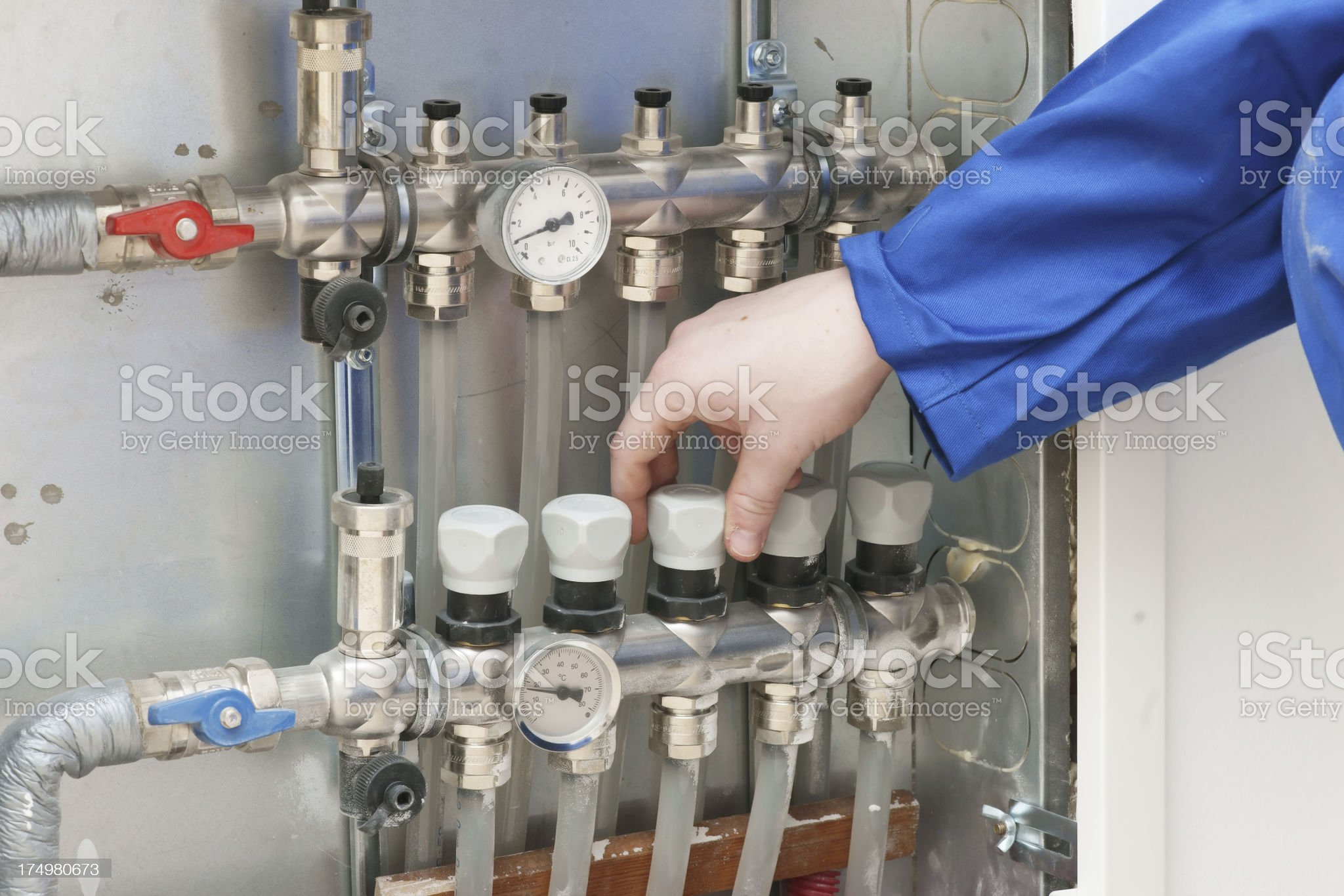 Adjusting under floor heating valves royalty-free stock photo