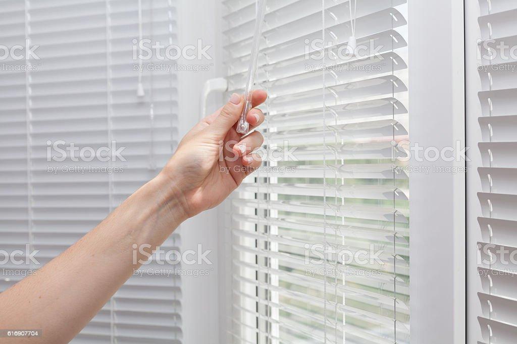 Adjustments room lighting range through the blinds stock photo