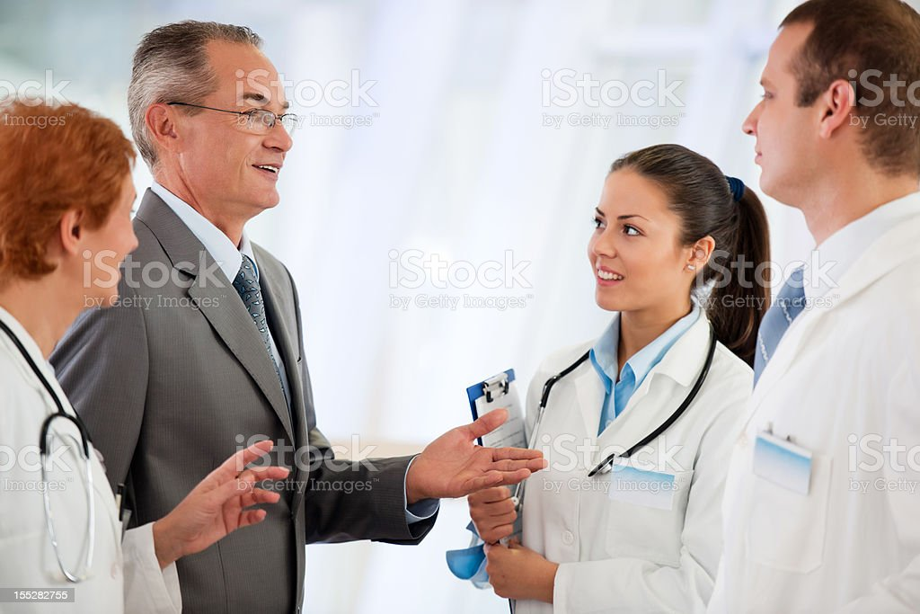Administrator talking with Medical team at the Hospital royalty-free stock photo