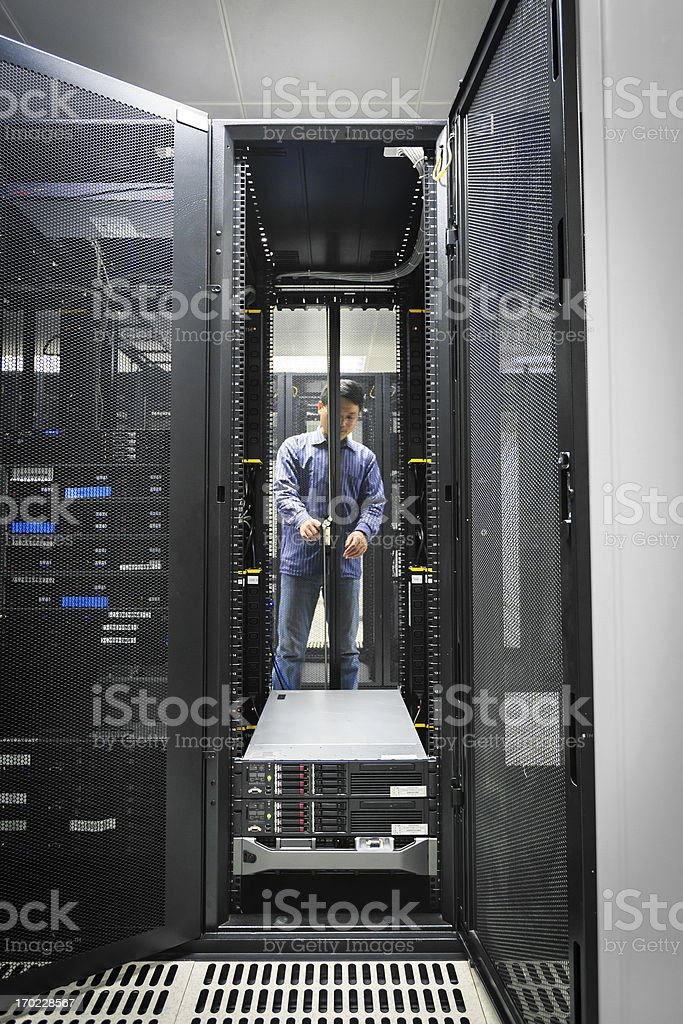 Administrator working on a server royalty-free stock photo