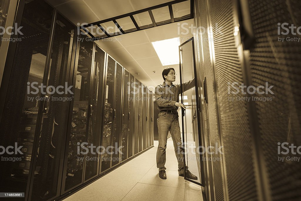 Administrator working on a server stock photo