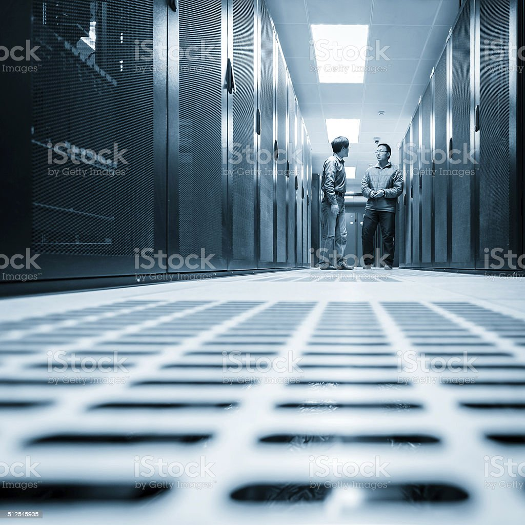 Administrators working on a server room stock photo