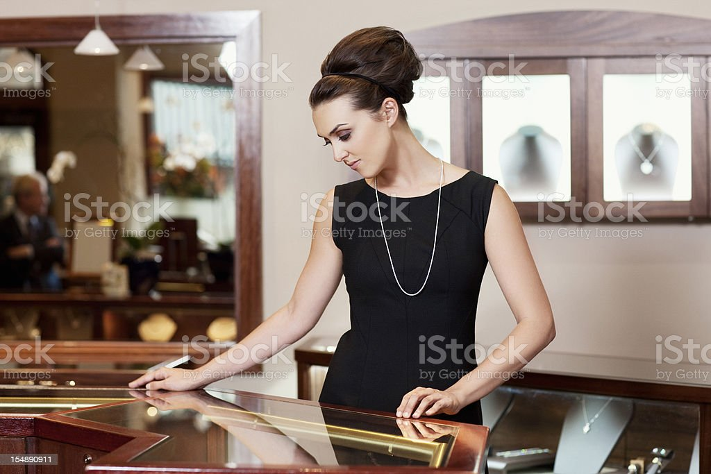 Admiring, Beautiful Young Woman in Jewelry Store, Copy Space stock photo