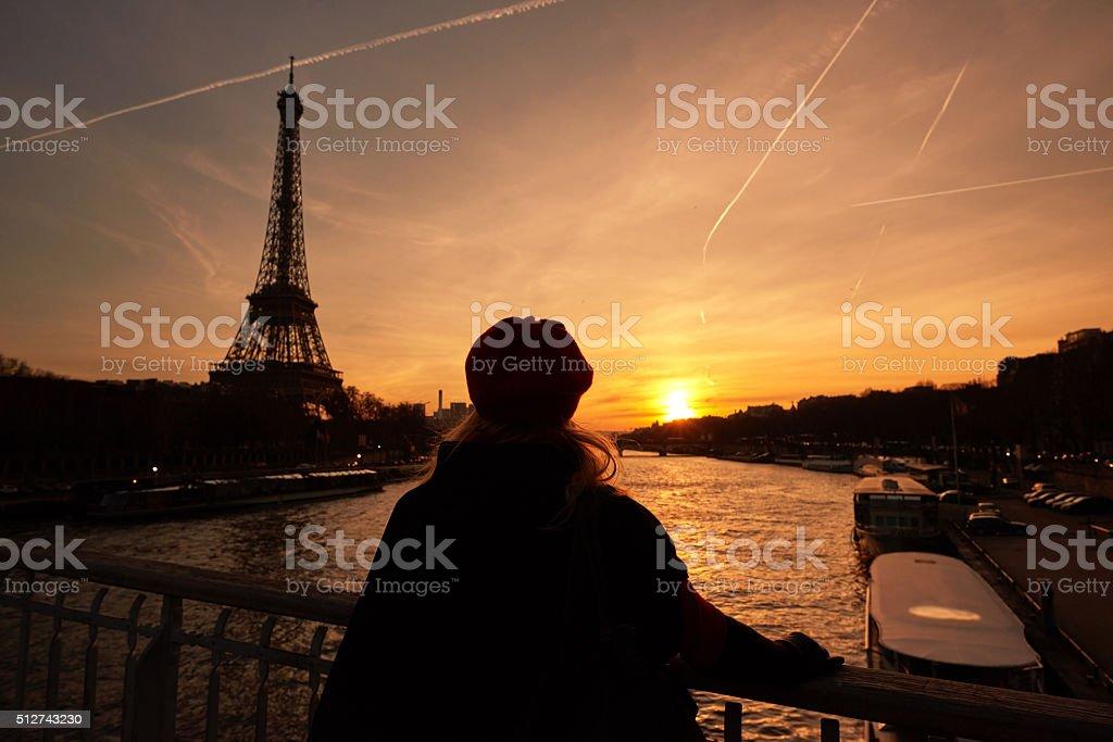admiring Eiffel tower at sunset stock photo