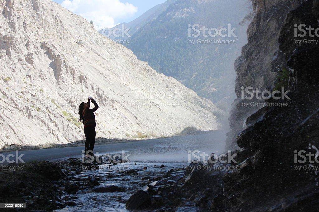 Admiring falling water stock photo
