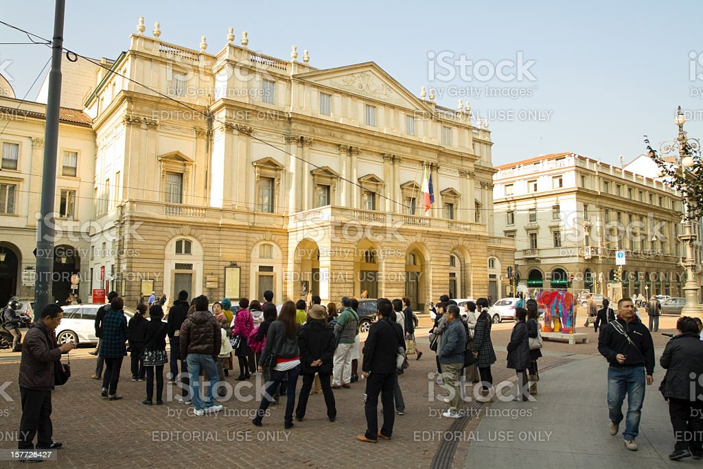 Admiring opera and theatre Scala in Milan stock photo