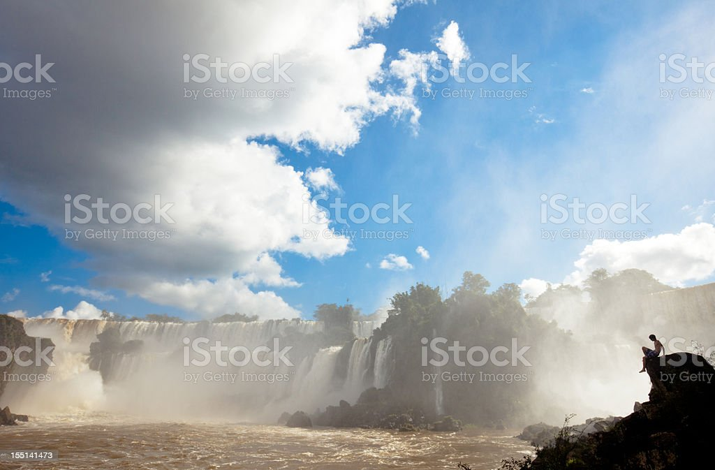 Admiring the power of nature at Iguazu falls royalty-free stock photo