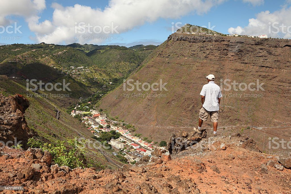 Admiring the view from trail above Jamestown St Helena Island stock photo