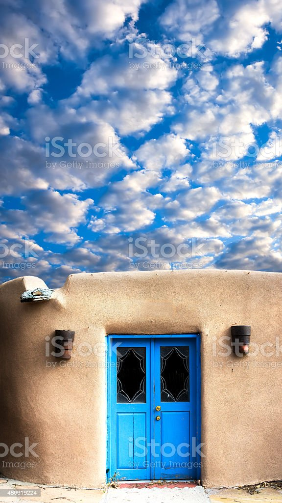 Adobe Building with a Blue Front Door stock photo