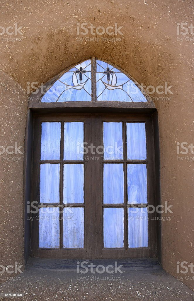 Adobe building with stained glass window royalty-free stock photo