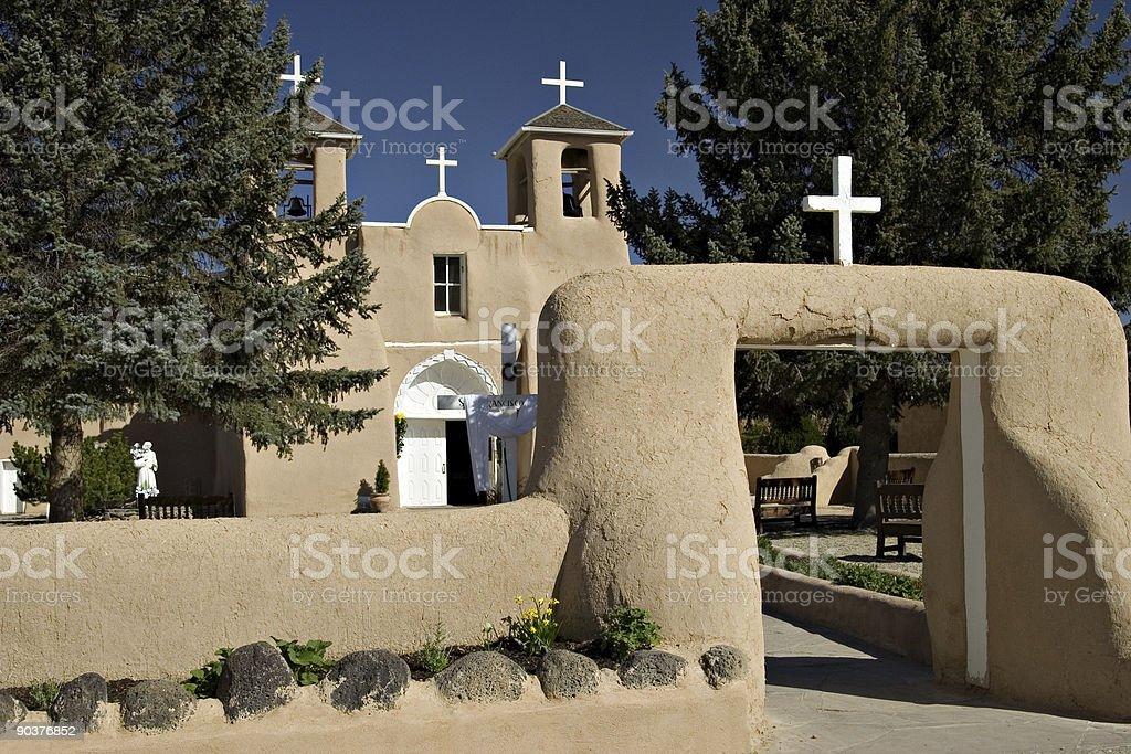 Adobe Catholic Church With White Crosses - Taos, New Mexico stock photo