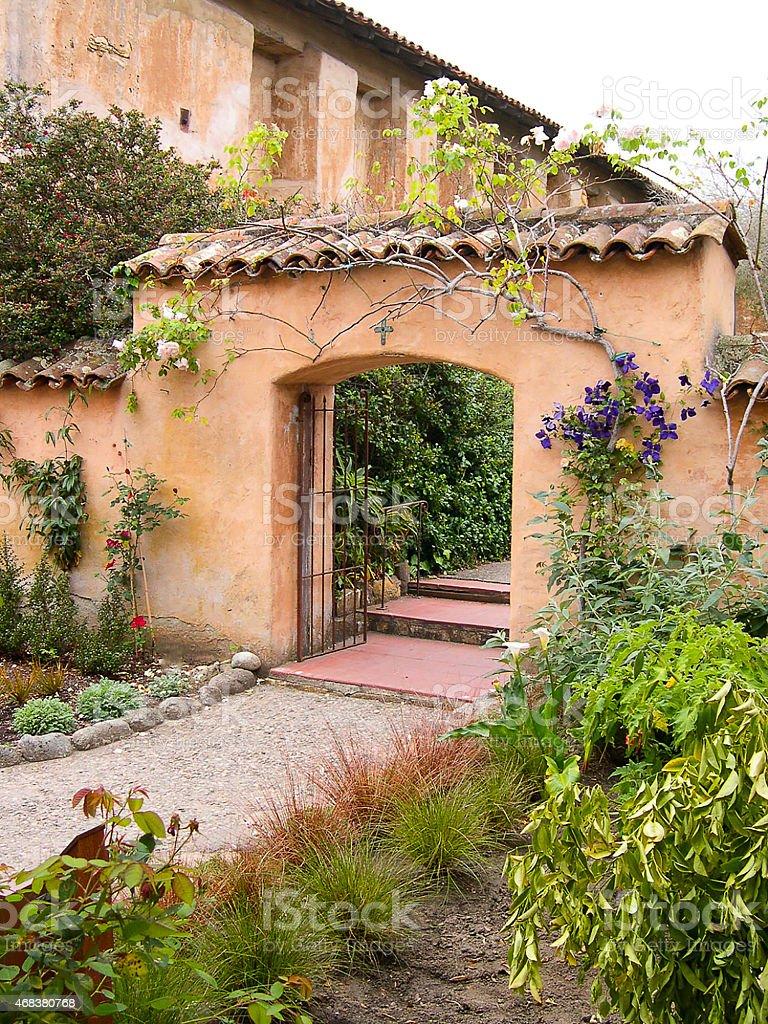Adobe Garden Gate and Footpath through Gardens California Historic Mission stock photo