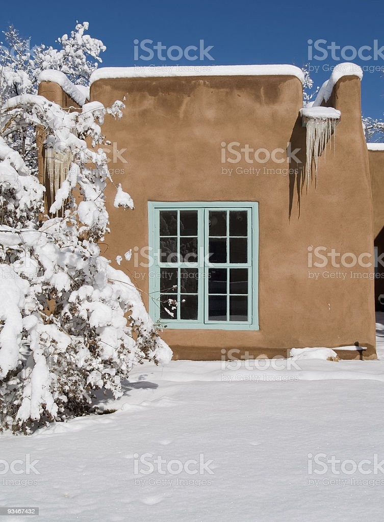 Adobe house in winter royalty-free stock photo