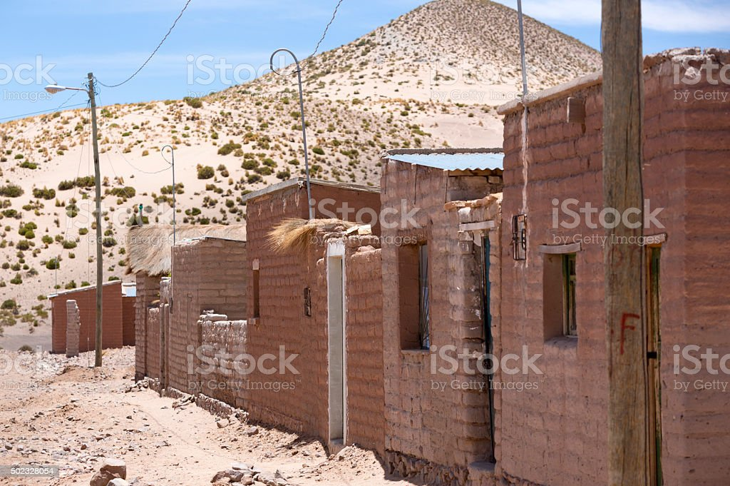 Adobe houses on Bolivian Altiplano with Andean mountain, Bolivia stock photo